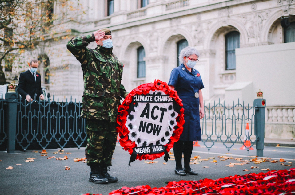 Donald Bell saluted the Cenotaph before laying the climate change wreath. (PA)