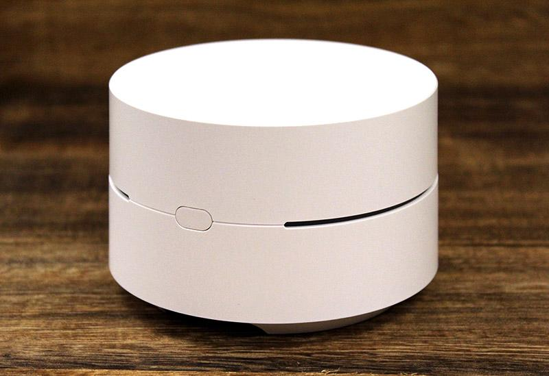 Google Wifi has a very clean design. A ring of LED light acts as a status indicator and there's a single reset button that's easily accessible on the side of the node.