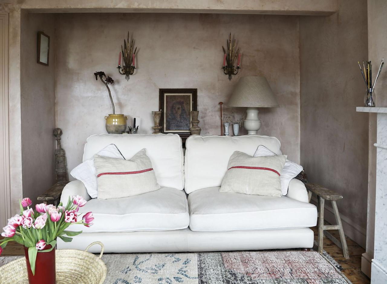 """<p>""""This cream sofa is like sitting on a cloud... it's so comfortable and came out of a house clearance in Holland Park. The giant pouffe takes centre stage in this room measuring 2.5m long and 1m wide. It's my favourite and one of my only new purchases from Anthropologie.""""</p>"""