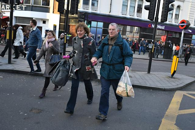 People heading away from the vicinity of Borough Market in London after police told them to leave the area. Photo: PA