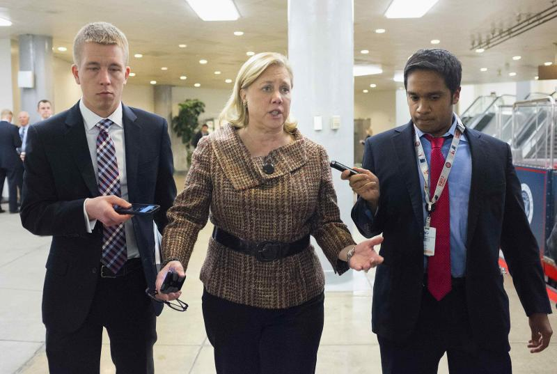 Senator Mary Landrieu (D-LA) speaks to reporters after the Democratic weekly policy luncheon on Capitol Hill in Washington January 28, 2014. REUTERS/Joshua Roberts (UNITED STATES - Tags: POLITICS)