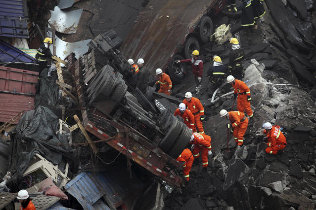 Rescuers work at the accident site where an expressway bridge partially collapsed due to a truck explosion in Mianchi County, Sanmenxia, central China's Henan Province, Thursday, Feb. 1, 2013. A truckload of fireworks intended for Lunar New Year celebrations went off Friday in a massive, deadly explosion that destroyed part of an elevated highway in central China, sending vehicles plummeting 30 meters (about 100 feet) to the ground. (AP Photo) CHINA OUT