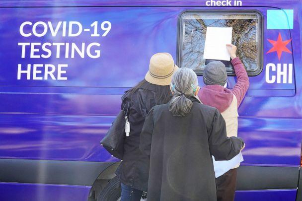 PHOTO: Residents check in for a COVID-19 test at a test site in Chicago, Nov. 12, 2020. (Scott Olson/Getty Images)