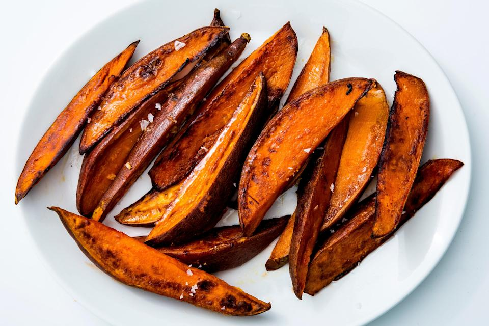 "Roasted, not fried, so you can use less oil. <a href=""https://www.bonappetit.com/recipe/roasted-sweet-potatoes-garlic-chili?mbid=synd_yahoo_rss"" rel=""nofollow noopener"" target=""_blank"" data-ylk=""slk:See recipe."" class=""link rapid-noclick-resp"">See recipe.</a>"