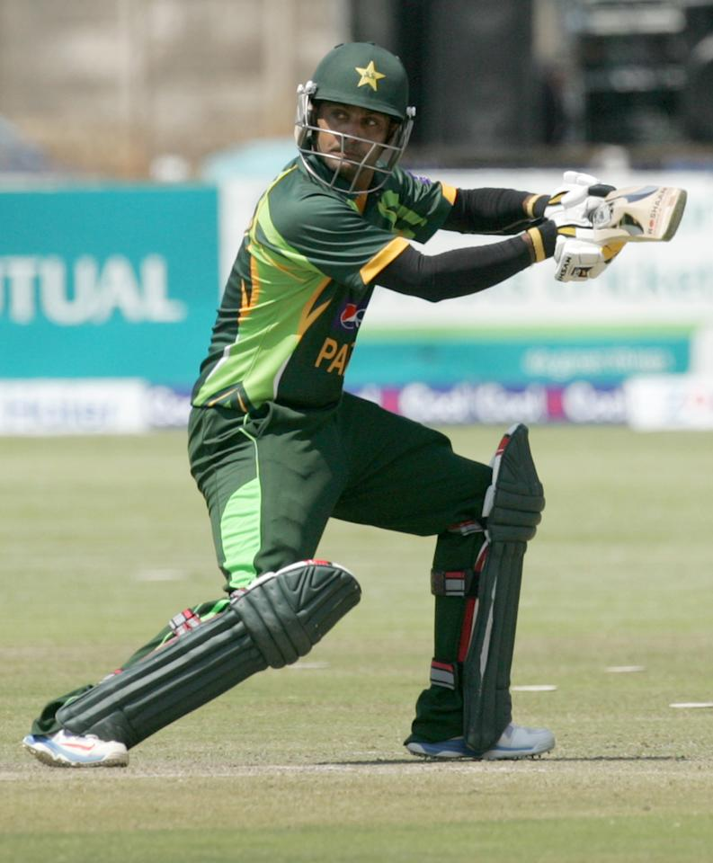 Pakistan's batsman Muhammad Hafeez bats during the 2nd game of the three match ODI cricket series between Pakistan and Zimbabwe at the Harare Sports Club on August 29, 2013. AFP PHOTO / JEKESAI NJIKIZANA        (Photo credit should read JEKESAI NJIKIZANA/AFP/Getty Images)