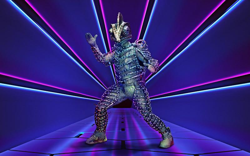 It turned out The Darkness frontman Justin Hawkins was underneath the chameleon costume: ITV