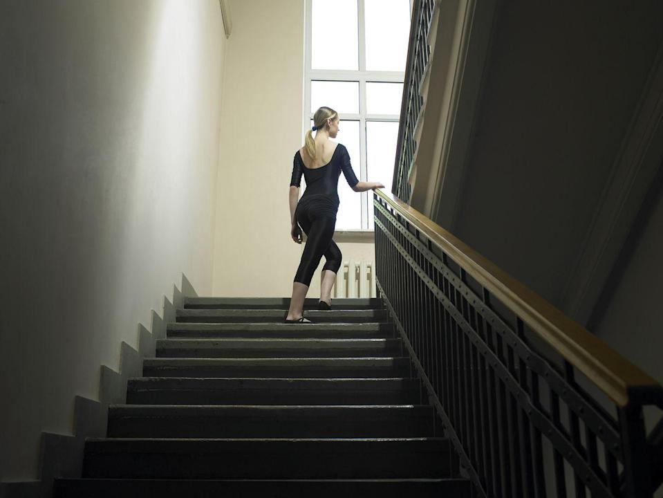 "<p>Taking the stairs cuts down on the energy use required to power the elevator. Plus, it's a great workout! </p><p><strong>RELATED:</strong> <a href=""https://www.goodhousekeeping.com/health/fitness/a31478709/home-workout/"" rel=""nofollow noopener"" target=""_blank"" data-ylk=""slk:The Best At-Home Workouts to Help You Stay Healthy and Fit, According to Personal Trainers"" class=""link rapid-noclick-resp"">The Best At-Home Workouts to Help You Stay Healthy and Fit, According to Personal Trainers</a></p>"