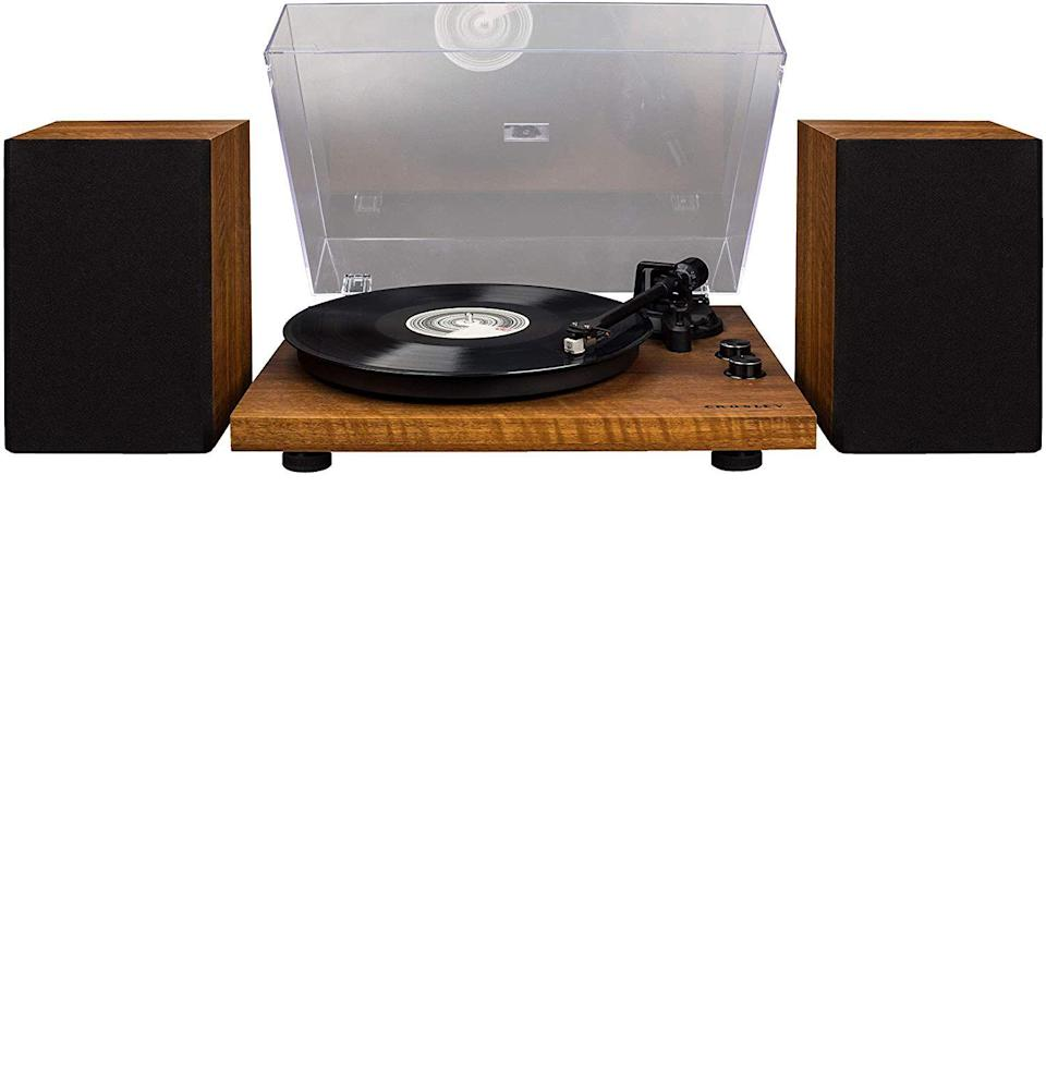 """<p><strong>Crosley</strong></p><p>amazon.com</p><p><strong>$199.95</strong></p><p><a href=""""https://www.amazon.com/dp/B07LCZBRD8?tag=syn-yahoo-20&ascsubtag=%5Bartid%7C10054.g.35269584%5Bsrc%7Cyahoo-us"""" rel=""""nofollow noopener"""" target=""""_blank"""" data-ylk=""""slk:Buy"""" class=""""link rapid-noclick-resp"""">Buy</a></p><p>Crosley is simply one of those brands that is a sure bet in the turntable and record player world for most folks. Pair that good reputation with a reasonable price point, and you have one of the most reliable turntables on the market.</p><p>What's great about this Bluetooth-enabled model is that it's technically ready to go out right of the box, and it will give you solid sound with its moving magnet cartridge. But it's easy to dismantle, too, making the option to customize with other attachments and cartridge upgrades down the road simpler than ever, if you so choose to level up.</p>"""