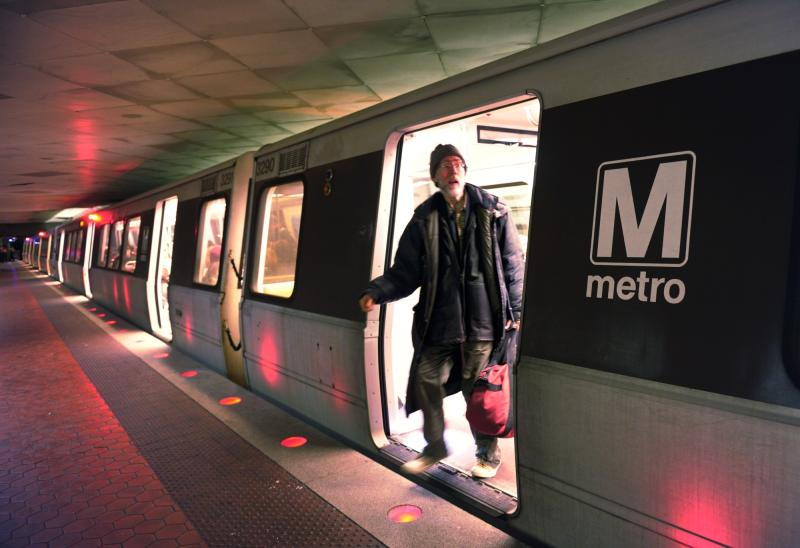 FILE -In this Friday, Feb. 12, 2010 file photo, a passenger gets off a red-line train at the Farragut North Metro Station in Washington. For decades, the economy in and around the Capital Beltway has benefited from the growth of the federal government. Now, as automatic federal budget cuts kick in, those same communities are bracing to take a disproportionate hit. (AP Photo/Susan Walsh, File)