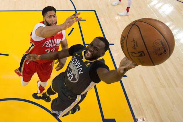April 7, 2018; Oakland, CA, USA; Golden State Warriors forward Draymond Green (23) shoots the basketball against New Orleans Pelicans forward Anthony Davis (23) during the first half at Oracle Arena. The Pelicans defeated the Warriors 126-120. Mandatory Credit: Kyle Terada-USA TODAY Sports TPX IMAGES OF THE DAY