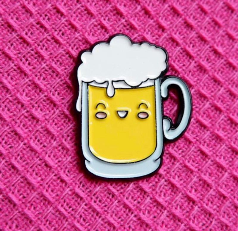 """Who wouldn't want the cutest anthropomorphized beer we've ever seen?! Get it <a href=""""https://www.etsy.com/ca/listing/723558027/cute-beer-pin-badge"""" target=""""_blank"""" rel=""""noopener noreferrer"""">on Etsy</a> for $7.16."""