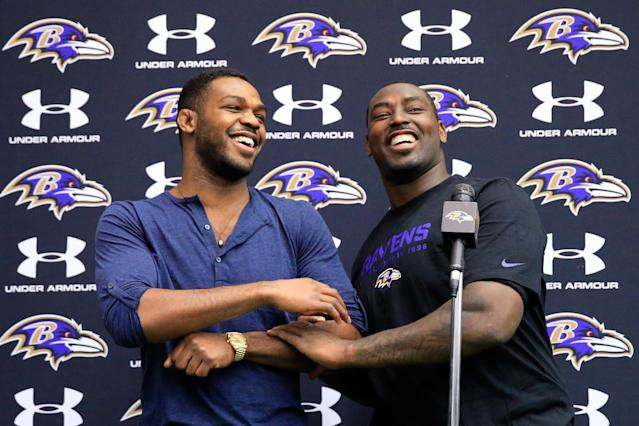 OWINGS MILLS, MD - NOVEMBER 13: UFC fighter Jon Jones (L) jokes around with his brother defensive end Arthur Jones #97 of the Baltimore Ravens during a news conference at the teams training facility November 13, 2013 in Owings Mills, Maryland. (Photo by Rob Carr/Getty Images)