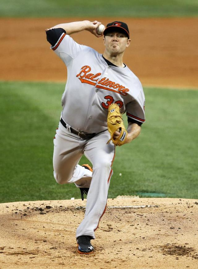 Baltimore Orioles starting pitcher Chris Tillman delivers during the first inning of a baseball game against the Chicago White Sox, Tuesday, Aug. 19, 2014, in Chicago. (AP Photo/Charles Rex Arbogast)
