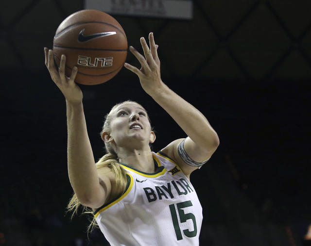 FILE - In this Oct. 25, 2019, file photo, Baylor's Lauren Cox (15) scores against Langston in the first half of an NCAA college exhibition basketball game in Waco, Texas. Cox was named to The Associated Press Preseason All-America women's college basketball team, Thursday, Oct. 31, 2019. (Jerry Larson/Waco Tribune Herald, via AP, File)