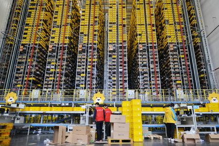 Employees work at a logistics base of Suning ahead of the Singles Day online shopping festival in Nanjing, Jiangsu province, China November 8, 2018. Picture taken November 8, 2018. REUTERS/Stringer