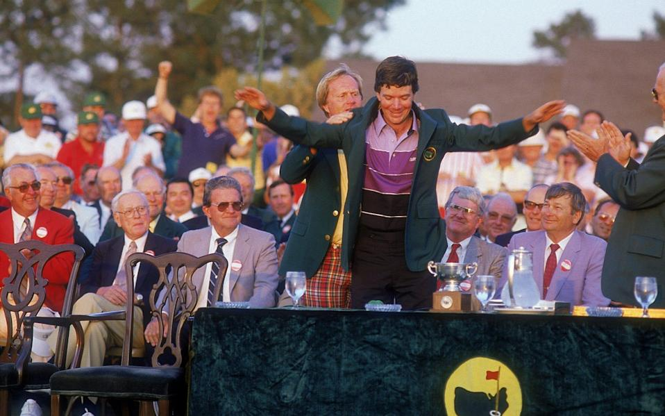 Jack Nicklaus of the USA presents Larry Mize of the USA with his green jacket after the thrilling US Masters 1987 second play-off hole held at the Augusta National Golf Course, in Augusta, Georgia - Getty Images Fee/David Cannon