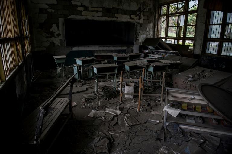 A thick layer of dust cakes the abandoned classroom that stands as a monument to those who lost their lives in the 2008 earthquake