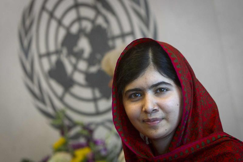 Pakistani schoolgirl activist Malala Yousafzai poses for pictures during a photo opportunity at the United Nations in the Manhattan borough of New York