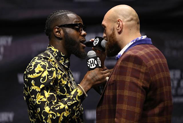 Deontay Wilder (L) and linear heavyweight champ Tyson Fury faced off in Los Angeles on Oct. 3, 2018 in Los Angeles to promote their upcoming fight. (Getty Images)