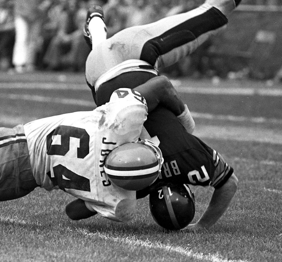 Defensive end Joe 'Turkey' Jones #64 of the Cleveland Browns sacks quarterback Terry Bradshaw #12 of the Pittsburgh Steelers during a game on October 10, 1976 at Cleveland Municipal Stadium in Cleveland, Ohio. Cleveland won 18-16. Bradshaw suffered a concussion as a result. (Getty)