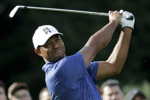 Tiger Woods tees off on the 12th hole during the first round of the Northern Trust golf tournament, Thursday, Aug. 23, 2018, in Paramus, N.J. (AP Photo/Julio Cortez)