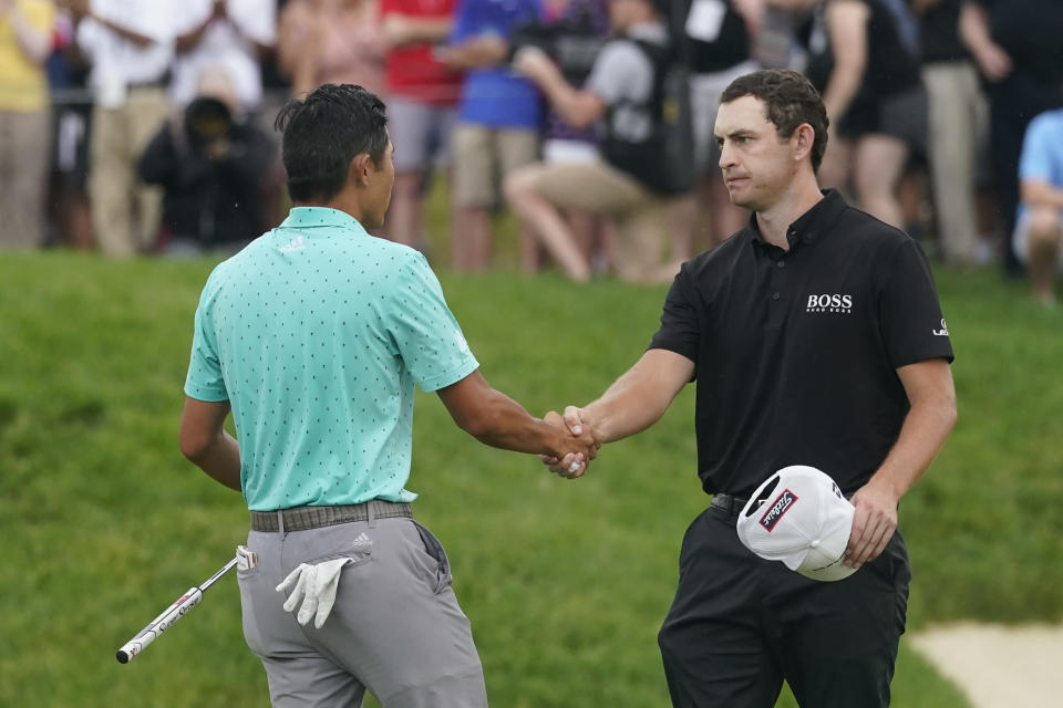 Patrick Cantlay, right, shakes hands with Collin Morikawa after Cantlay won the Memorial golf tournament, Sunday, June 6, 2021, in Dublin, Ohio. (AP Photo/Darron Cummings)