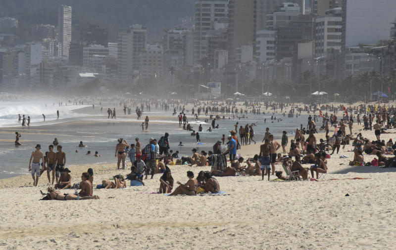 People ignore the Coronavirus pandemic, covid 19, and crowd in bathers on Ipanema beach, Rio de Janeiro, Brazil on August 13, 2020 and Brazil has more than 3 million confirmed cases of coronavirus. The death toll from Covid-19 in the country is over 103,000. (Photo by Fabio Teixeira/NurPhoto via Getty Images)