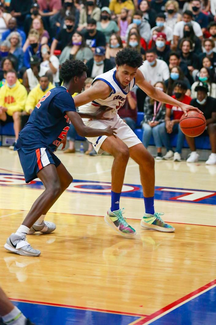 Los Altos' Jazz Gardner is defended by a Rolling Hills Prep player.