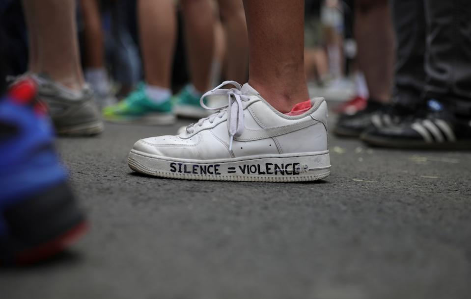 A demonstrator displays a message of protest on shoes as protesters rally against the death in Minneapolis police custody of George Floyd, near the White House in Washington, U.S., June 3, 2020. (REUTERS/Tom Brenner)
