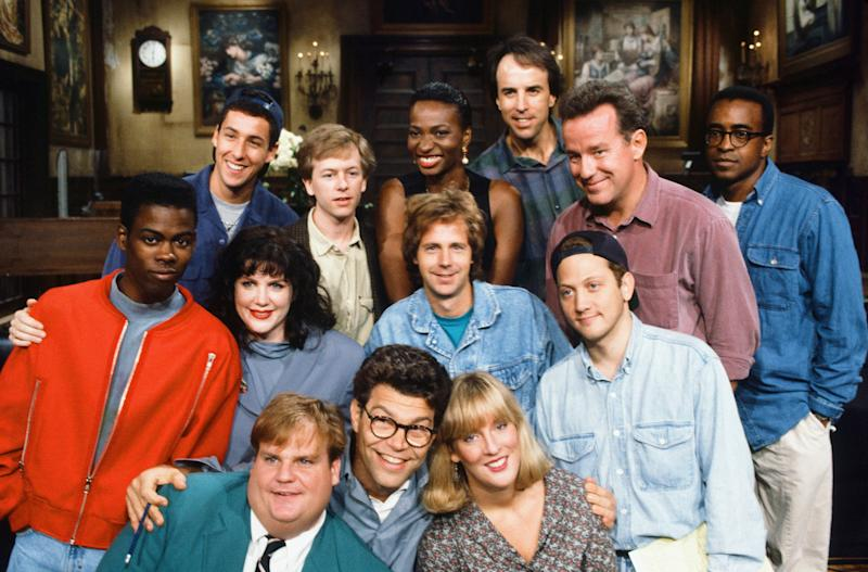 Al Franken is seen among SNL's Season 18 cast members in 1992. The women include Melanie Hutshell, seen in the bottom row to his left, Julia Sweeney, and Ellen Cleghorne.