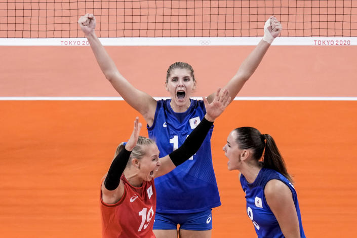 Russian Olympic Committee team players celebrate their victory over China during a women's volleyball preliminary round pool B match between China and Russian Olympic Committee at the 2020 Summer Olympics, Thursday, July 29, 2021, in Tokyo, Japan. (AP Photo/Manu Fernandez)