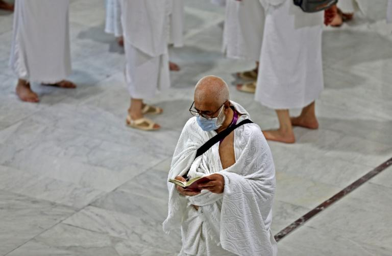 Muslim pilgrims wear masks at the Grand Mosque in Saudi Arabia's holy city of Mecca