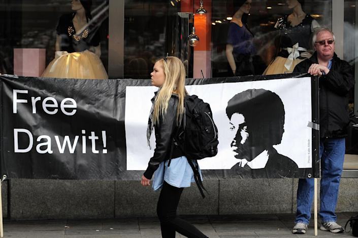 A man holds a banner with Swedish-Erythree journalist Dawit Isaak's portrait, on May 3, 2010, in Stockholm (AFP Photo/Olivier Morin)