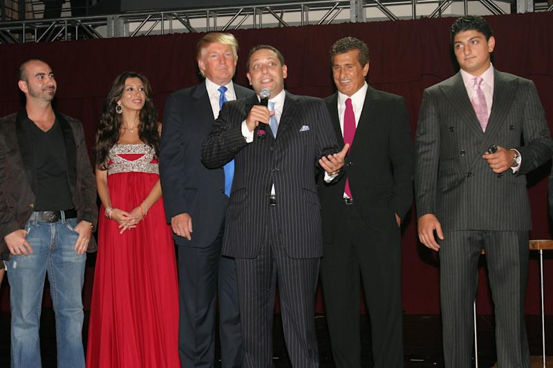 Felix Sater (center, holding the microphone) attends a launch party for the Trump Soho Hotel Condominium in Manhattan on Sept. 19, 2007. (Patrick McMullan via Getty Images)