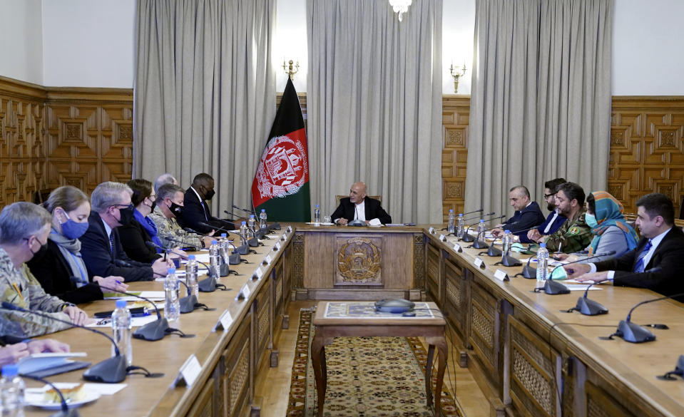 Afgan President Ashraf Ghani, center, meets with U.S. Defense Secretary Lloyd Austin, center left, and their delegations, at the presidential palace in Kabul, Afghanistan, Sunday, March 21, 2021. Austin arrived in Kabul on his first trip to Afghanistan as Pentagon chief, amid swirling questions about how long American troops will remain in the country. (Presidential Palace via AP)