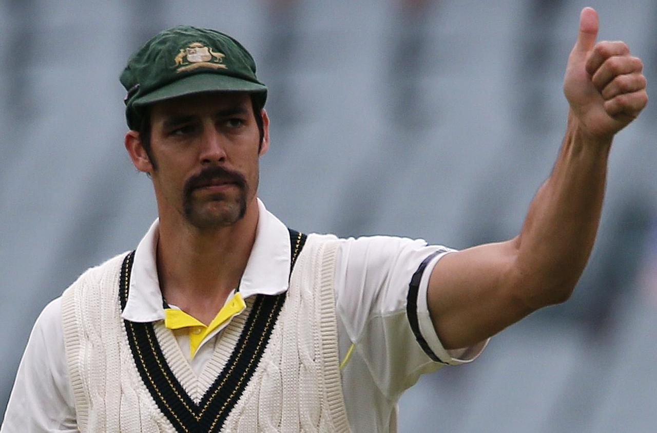 Australia's Mitchell Johnson gives a thumbs up to supporters after winning the second Ashes cricket test against England at the Adelaide Oval December 9, 2013. Australia captured England's four remaining wickets before lunch to close out an emphatic 218-run victory in the second Ashes test on Monday. REUTERS/David Gray (AUSTRALIA - Tags: SPORT CRICKET)