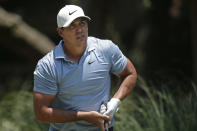 Brooks Koepka watches his shot off the second tee during the final round of the RBC Heritage golf tournament, Sunday, June 21, 2020, in Hilton Head Island, S.C. (AP Photo/Gerry Broome)