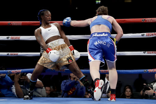 Claressa Shields, left, avoids a punch from Belgium's Femke Hermans, during their WBC/IBF/WBA middleweight title boxing match, Saturday, Dec. 8, 2018, in Carson, Calif. (AP Photo/Chris Carlson)