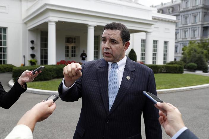 FILE - In this Sept. 13, 2017 file photo, Rep. Henry Cuellar, D-Texas, speaks with reporters outside the West Wing after a bipartisan meeting with President Donald Trump at the White House, in Washington. Kristie Small, a former senior aide to Cuellar has filed a lawsuit against the Texas Democrat in Washington D.C. on Monday that claims she was wrongly fired for being pregnant. The lawsuit argues Cuellar's firing of Small was both sex and pregnancy discrimination in violation of the Congressional Accountability Act of 1995. (AP Photo/Alex Brandon, File)