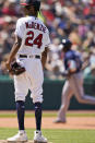 Cleveland Indians starting pitcher Triston McKenzie, left, waits for Tampa Bay Rays' Nelson Cruz to run the bases after Cruz hit a solo home run in the sixth inning of a baseball game, Sunday, July 25, 2021, in Cleveland. (AP Photo/Tony Dejak)