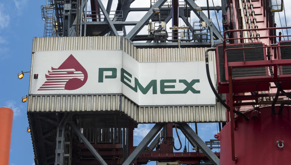 """The PEMEX logotype on the tower of the drilling tower of La Muralla IV exploration oil rig, operated by Mexican company """"Grupo R"""" and working for Mexico's state-owned oil company  PEMEX, in the Gulf of Mexico on August 30, 2013. The semisubmersible platform is able to drill to a depth of 10.000 meters in an enviroment such as the Gulf of Mexico.    AFP PHOTO/OMAR TORRES        (Photo credit should read OMAR TORRES/AFP via Getty Images)"""