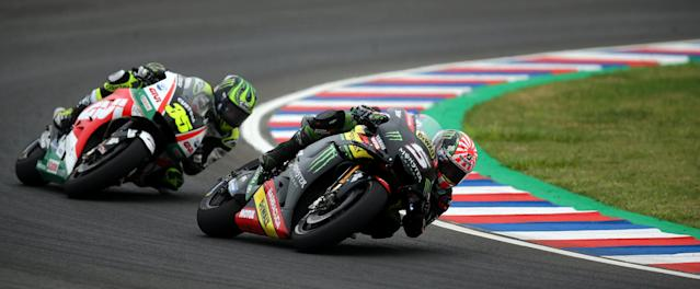 Motorcycle Racing - Argentina Motorcycle Grand Prix - MotoGP race - Termas de Rio Hondo, Argentina - April 8, 2018 - Monster Yamaha Tech 3 rider Johann Zarco (5) of France and LCR Honda Castrol rider Cal Crutchlow of Britain compete. REUTERS/Marcos Brindicci