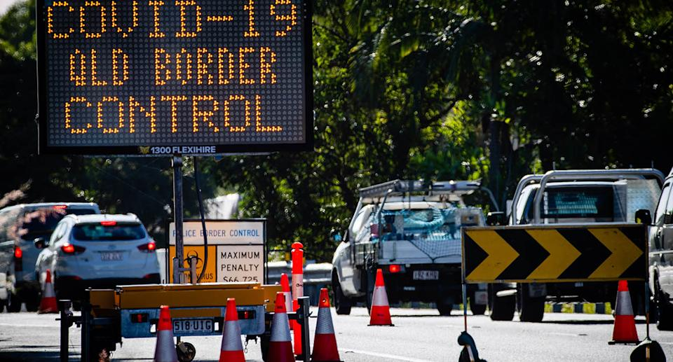 A sign on the road at the Queensland border reading: 'Covid-19 Queensland border control.'