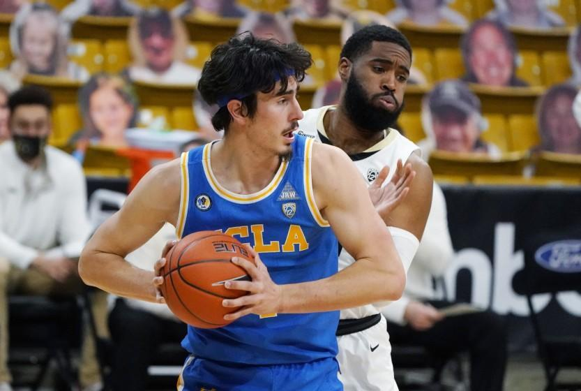 UCLA guard Jaime Jaquez Jr., front, pulls in a rebound in fornt of Colorado forward Jeriah Horne in the second half of an NCAA college basketball game Saturday, Feb. 27, 2021, in Boulder, Colo. Colorado won 70-61. (AP Photo/David Zalubowski)