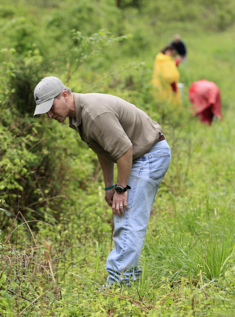 Michael Rose, of Gallatin, Tenn., searches with other volunteers along a rural road for evidence in the disappearance of Holly Bobo on Friday, April 15, 2011, in Parsons, Tenn. Authorities say Bobo, 20, may have been abducted from her family home Wednesday. (AP Photo/Mark Humphrey)