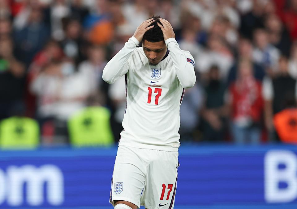 LONDON, ENGLAND - JULY 11: Jadon Sancho of England looks dejected after missing their team's fourth penalty as it is saved during a penalty shoot out during the UEFA Euro 2020 Championship Final between Italy and England at Wembley Stadium on July 11, 2021 in London, England. (Photo by Eddie Keogh - The FA/The FA via Getty Images)