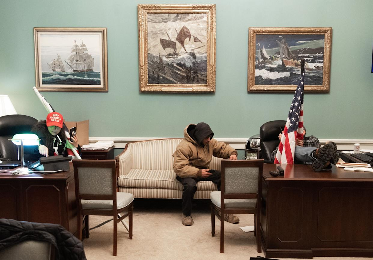 Intruders holding American flags invade Pelosi's office suite in the U.S. Capitol. (Photo: SAUL LOEB via Getty Images)