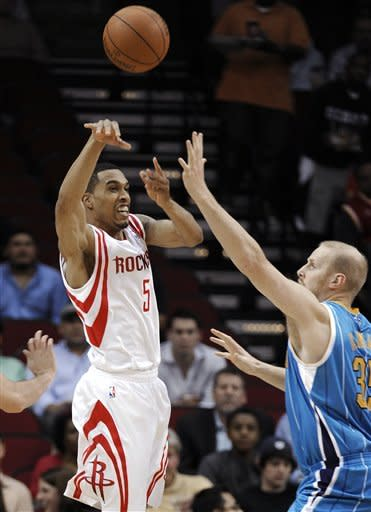 Houston Rockets guard Courtney Lee (5) passes the ball away from New Orleans Hornets center Chris Kaman (35) during the first half of an NBA basketball game Thursday, Jan. 19, 2012, in Houston. (AP Photo/Pat Sullivan)
