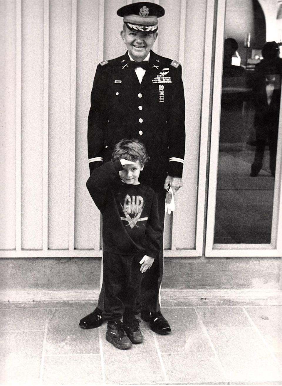 Jim Goetcheus stands in uniform with his grandchild, Ryan Sarfan, in 1994, at his daughter's wedding. Goetcheus served as a career military officer for more than 20 years, including two tours in Vietnam where he earned a Purple Heart and a Bronze Star. He wanted to have a funeral at Arlington National Cemetery.