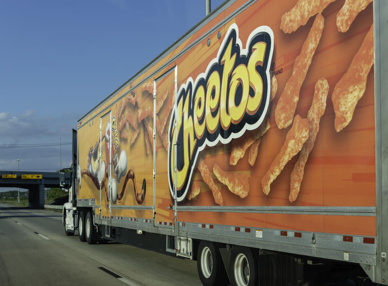 A semi-truck carrying Cheetos snacks on Interstate 75 outside of Woodhaven, Michigan. Cheetos are a snack food made by Pepsi subsidiary Frito-Lay.